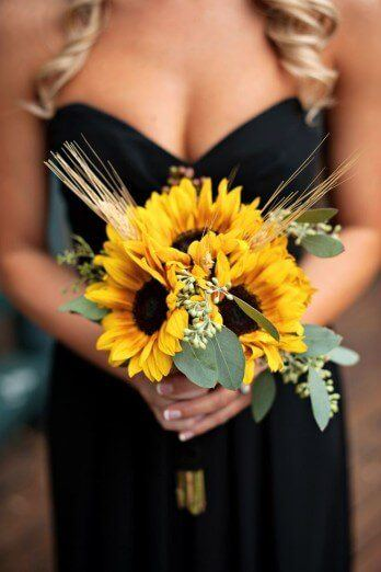 Sunflower bouquet with ears of wheat