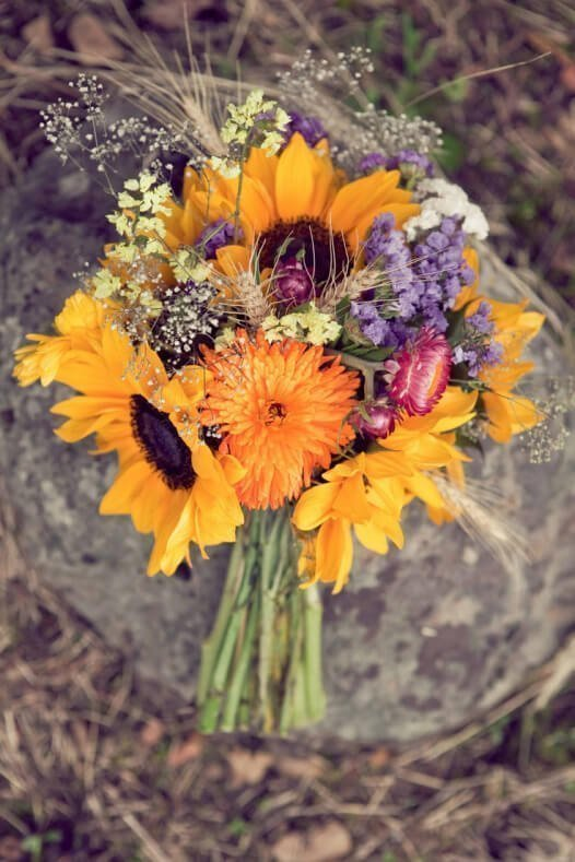 Sunflower bouquet with strawflowers and wildflowers