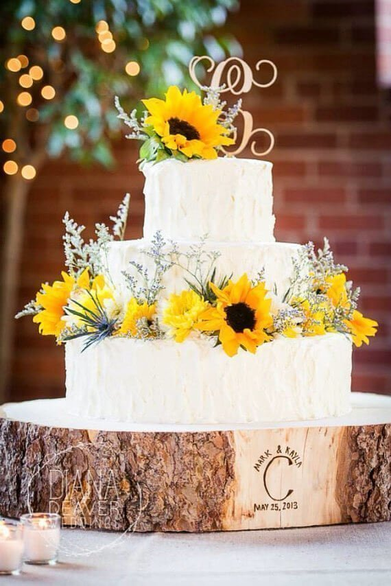 Cake decorated with sunflowers on wooden planks