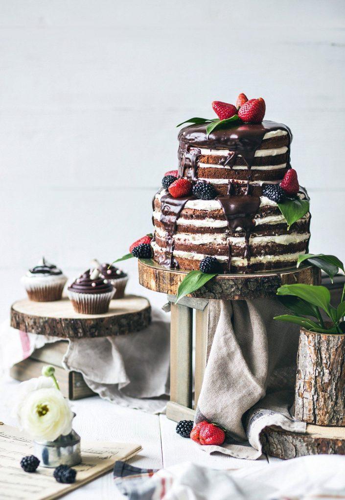 Dark naked cake with strawberries