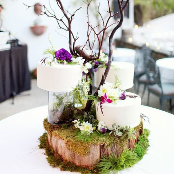Three small cakes decorated with flowers