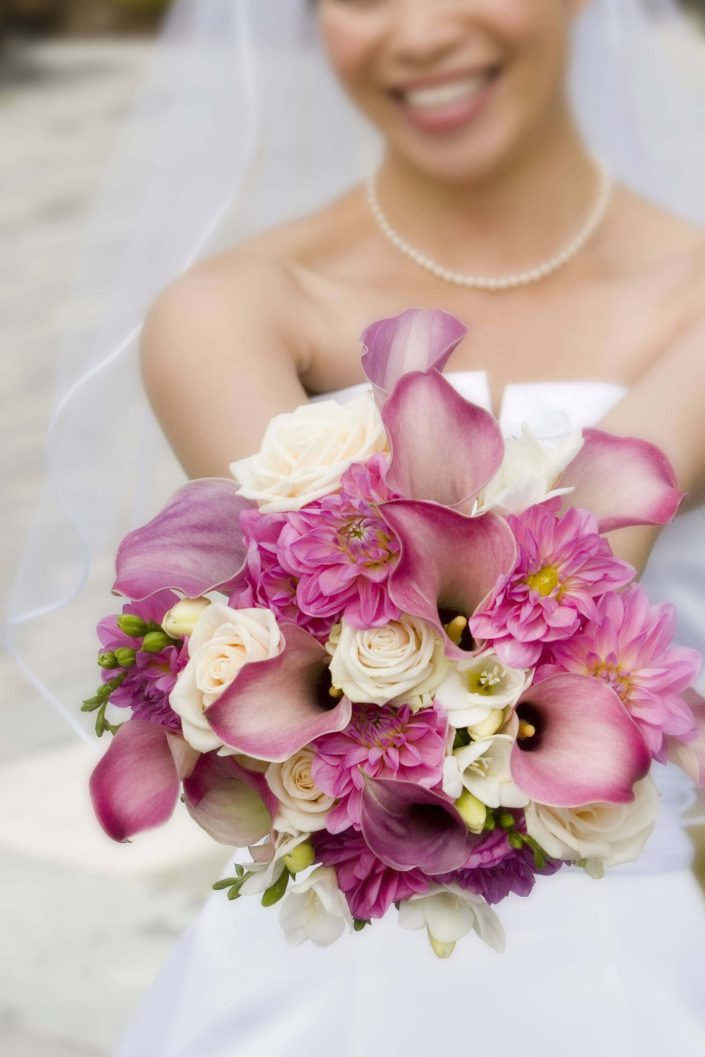 bouquet of pink calla lilies dahlias and roses