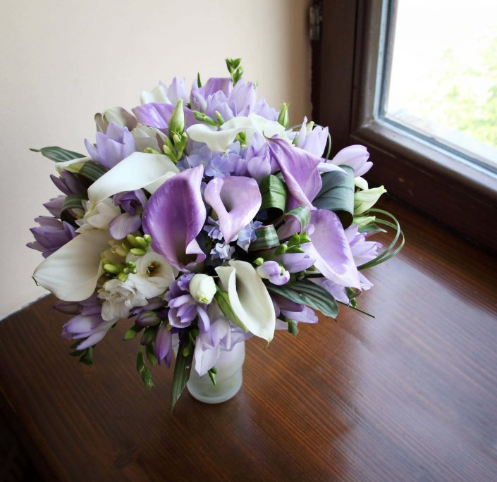 wedding bouquet of purple and white calla lilies